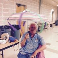 Dan helping Dorean with umbrella_768x768.jpg